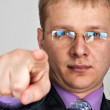 Businessman pointing to you — Stock Photo
