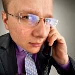 Bizarre businessman talking by phone — Stock Photo