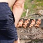 Man grilling shish kebab — Stock Photo #5549761