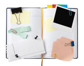 Open business diary with clipped papers — Stock Photo