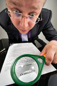 Bizarre businessman examining the agreement — Stock Photo