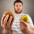Fast food VS healthy food — Stock Photo