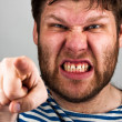 Angry bearded man pointing to you — Stock Photo #5590529