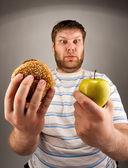 Fast food VS healthy food — Stock Photo