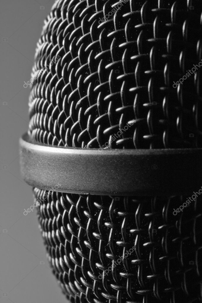 Close-up view of a modern black microphone. Isolated — Stock Photo #5751460