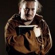 Monk with bible and rosary — Stock Photo #5760996