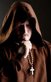 Monk in shadow — Stock Photo