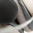 Professional studio microphone and headphones — Stock Photo