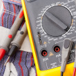 Digital multimeter, probes and gloves — Stock Photo