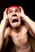 Terrified screaming man holding his head — Stock Photo