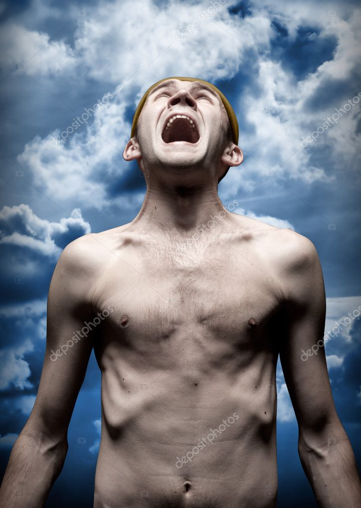 Portrait of despaired screaming man against dramatic sky — Photo #5973564