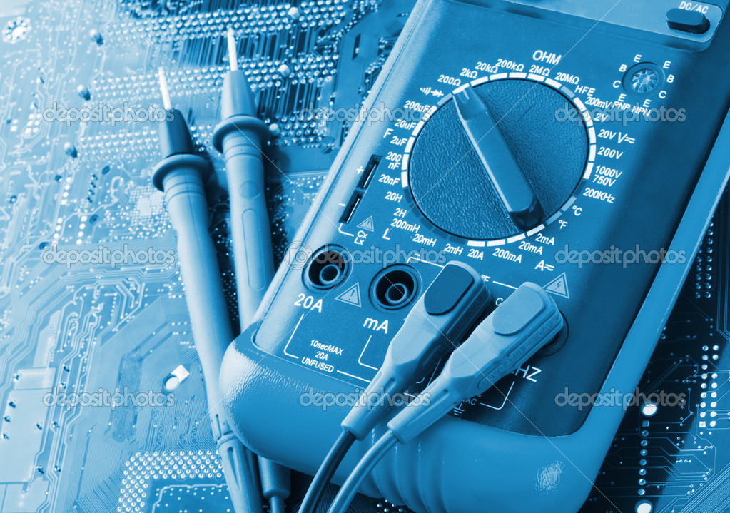 Close-up of digital multimeter on electronics circuit — Stock Photo #5973575