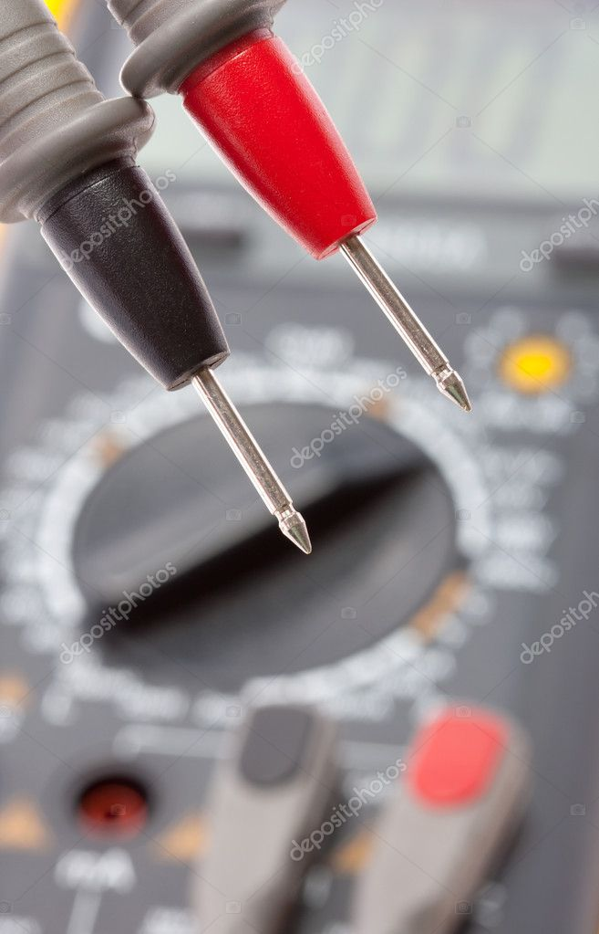 Red and black probes against digital multimeter  Stock Photo #5973584