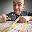Stock Photo: Funny tourist discovering map