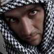 Serious middle eastern man looking to you — Stock Photo