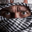 Scared middle eastern man looking to you - Foto Stock