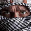 Stock Photo: Scared middle eastern mlooking to you
