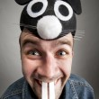 Funny man in rabbit hat — Stock Photo