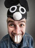 Funny man in rabbit hat — Zdjęcie stockowe