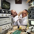 Wo funny scientists fighting at laboratory — Stock Photo #6072523