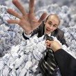 Helping hand saving buried businessman — Stock Photo