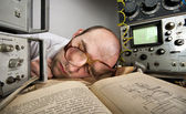 Exhausted scientist sleeping on book — Stock Photo