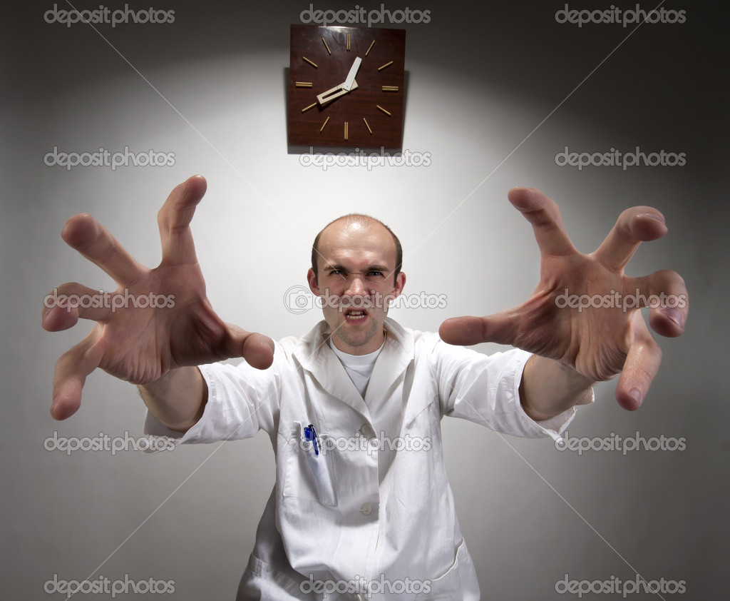 Ominous angry doctor reaching his long hands — Stock Photo #6072558