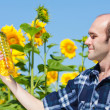 Farmer holding bottle of sunflowers oil — Photo