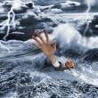 Businessman sinking in dark stormy sea — Stock Photo