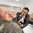 Businessmen fighting in the office — Stock Photo #6456563
