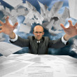 Serious businessman manipulating papers — Stock Photo #6456565
