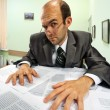 Serious businessman working in office — Stock Photo #6456573