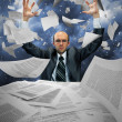 Serious businessman manipulating papers — Stockfoto