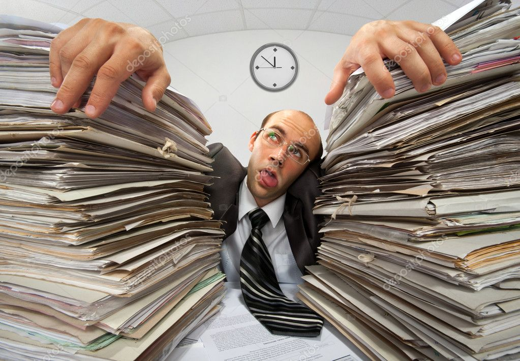 Exhausted businessman has had too much of his paperwork — Stock Photo #6456580