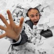 Businessman sinking in heap of documents - Stockfoto