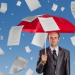 Businessman with red umbrella under falling documents - Stockfoto