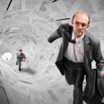 Businessmen running inside documents tunnel — Stock Photo #6639828