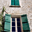 Royalty-Free Stock Photo: Old facade with windows with green shutters