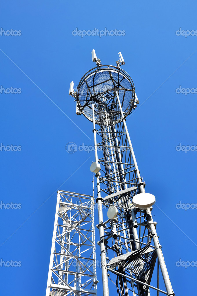 Relay antenna on blue sky background — Stock Photo #6208360