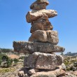 Cairn on blue sky — Stock Photo