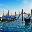Gondolas and San Giorgio maggiore in Venice - Stock Photo