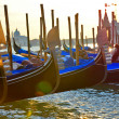 Row of gondolas on sunset, Venice — Photo