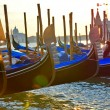Row of gondolas on sunset, Venice - Stock Photo