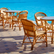 Table and chairs by the pool — Stock Photo