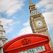 Red telephone booth and Big Ben - Stock Photo