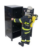 Fireman with Locker — Stock Photo