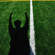 Shadow of AmericFootball Referee Signaling Touchdown — Stock Photo #6052800