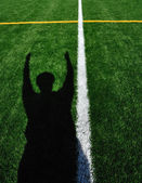 Shadow of American Football Referee Signaling Touchdown — Stock Photo