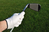 Golfer Holding an Iron (Golf Club) — Stock Photo