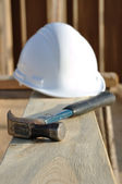 Claw Hammer and Hard Hat on Board — Stock Photo